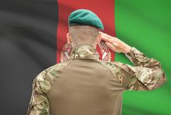 Soldier in hat facing national flag series - Afghanistan Stock Photos