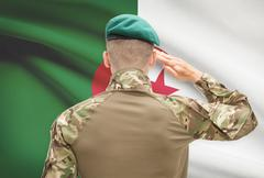 Soldier in hat facing national flag series - Algeria - stock photo