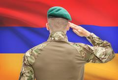 Soldier in hat facing national flag series - Armenia Stock Photos