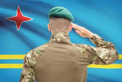Soldier in hat facing national flag series - Aruba - stock photo