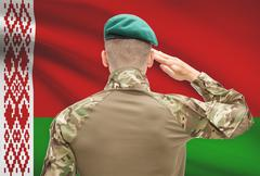 Soldier in hat facing national flag series - Belarus Stock Photos
