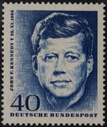 John F Kennedy President of the USA on a German commemorative stamp 1964 Stock Photos