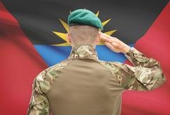 Soldier in hat facing national flag series - Antigua and Barbuda Stock Photos