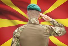 Stock Photo of Soldier in hat facing national flag series - Macedonia