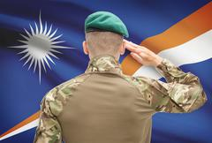 Soldier in hat facing national flag series - Marshall Islands - stock photo