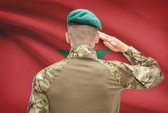 Soldier in hat facing national flag series - Morocco - stock photo
