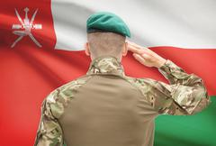 Soldier in hat facing national flag series - Oman Stock Photos