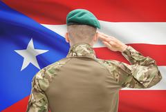 Soldier in hat facing national flag series - Puerto Rico Stock Photos