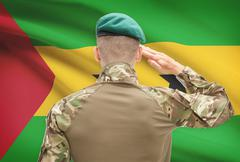 Soldier in hat facing national flag series - Sao Tome and Principe - stock photo