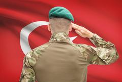 Soldier in hat facing national flag series - Turkey - stock photo
