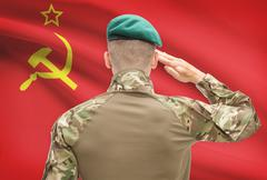 Soldier in hat facing national flag series - USSR - Soviet Union - stock photo