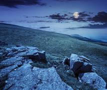 white boulders on the hillside at night - stock photo