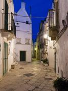Blue hour dusk alleyway Locorotondo Apulia Italy Europe Stock Photos