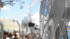 Fans humidified air blown crowd of people Stock Footage