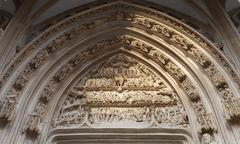 Tympanum on the portal the Church of Saint Maclou Flamboyant style of Gothic Stock Photos