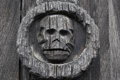 Skull danse macabre carving medieval plague cemetery Aitre de Saint Maclou - stock photo