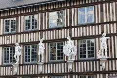 Norman halftimbered house with decorative figures on the facade Rouen - stock photo