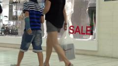 Shopping Mall People - 24 - Vitrine with Sale Sign Stock Footage