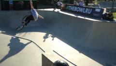 BMX rider performs tricks in the skate park and the falls. Stock Footage