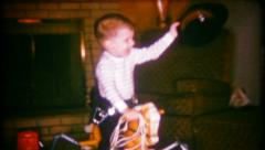 2297 - cowboy rides his rocking horse on Christmas - vintage film home movie Stock Footage