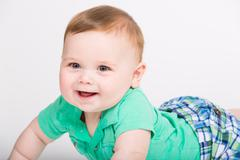 Baby Smiling on Stomach Close Up - stock photo