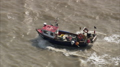AERIAL United Kingdom-Small Fishing Boat In Choppy Seas - stock footage