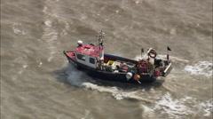 Stock Video Footage of AERIAL United Kingdom-Small Fishing Boat In Choppy Seas