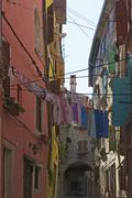 Laundry drying on the line in an alley in the old town Rovinj Istria Croatia Stock Photos