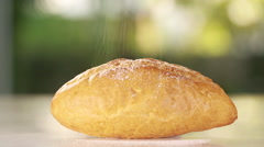 Powder sugar being poured over bread, Closeup shot Stock Footage