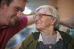 Woman 89 years talking to a nurse for the elderly nursing home - stock photo