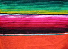 mexican handwoven rug poncho fiesta with stripes and bright colors - stock photo