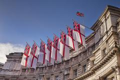 Admiralty Arch flying White Ensigns the flag of the Royal Navy London England - stock photo