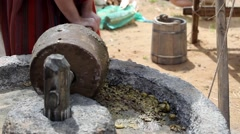 Process of making olive oil in ancient times Stock Footage