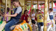 Children Enjoying Amusement Park Attraction 2 - stock footage