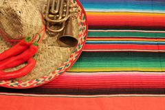 striped poncho serape fiesta background with copyspace - stock photo