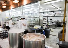 Open chinese commercial kitchen in a restaurant - stock photo
