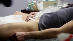 Hair removal (depilation) in man intimate area - stock footage