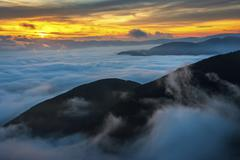 Stock Photo of Sunrise above the clouds Mount Cucco Umbria Apennines Italy Europe