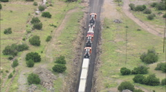 AERIAL United States-Long Frieght Train Over Bridge Stock Footage