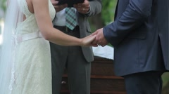 Bride And Groom Holding Hands While Pastor Speaks Wedding - stock footage