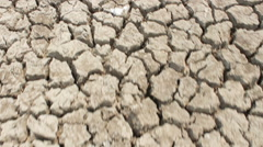 Brown surface of crack clay, view from above in motion Stock Footage