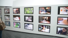Milano Expo 2015 Pavilion of Italy Installation of monitors with children Stock Footage