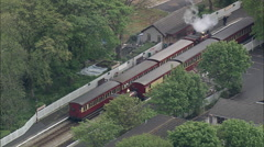 AERIAL Isle of Man-501 Steam Train Out Of Ballasalla Stock Footage