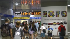 Train station in Milan. People walk through the tunnel in a hurry for the train Stock Footage