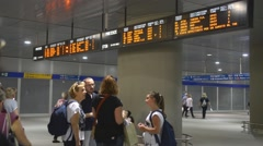 Train station in Milan. People watching the train schedule Stock Footage