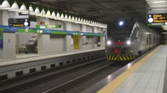 Train Trenord Milan arrives at the station Stock Footage