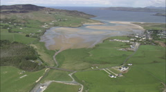 AERIAL Ireland-Flight Low Over Sea Revealing Dunfanaghy Stock Footage
