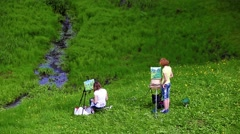 Two painters girls are drawing in the park Stock Footage