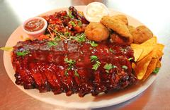 Tex mex baby back BBQ ribs and wings platter with nachos Stock Photos