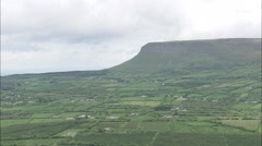 AERIAL Ireland-Flight From Ben Bulben Revealing Drumcliffe Church Stock Footage